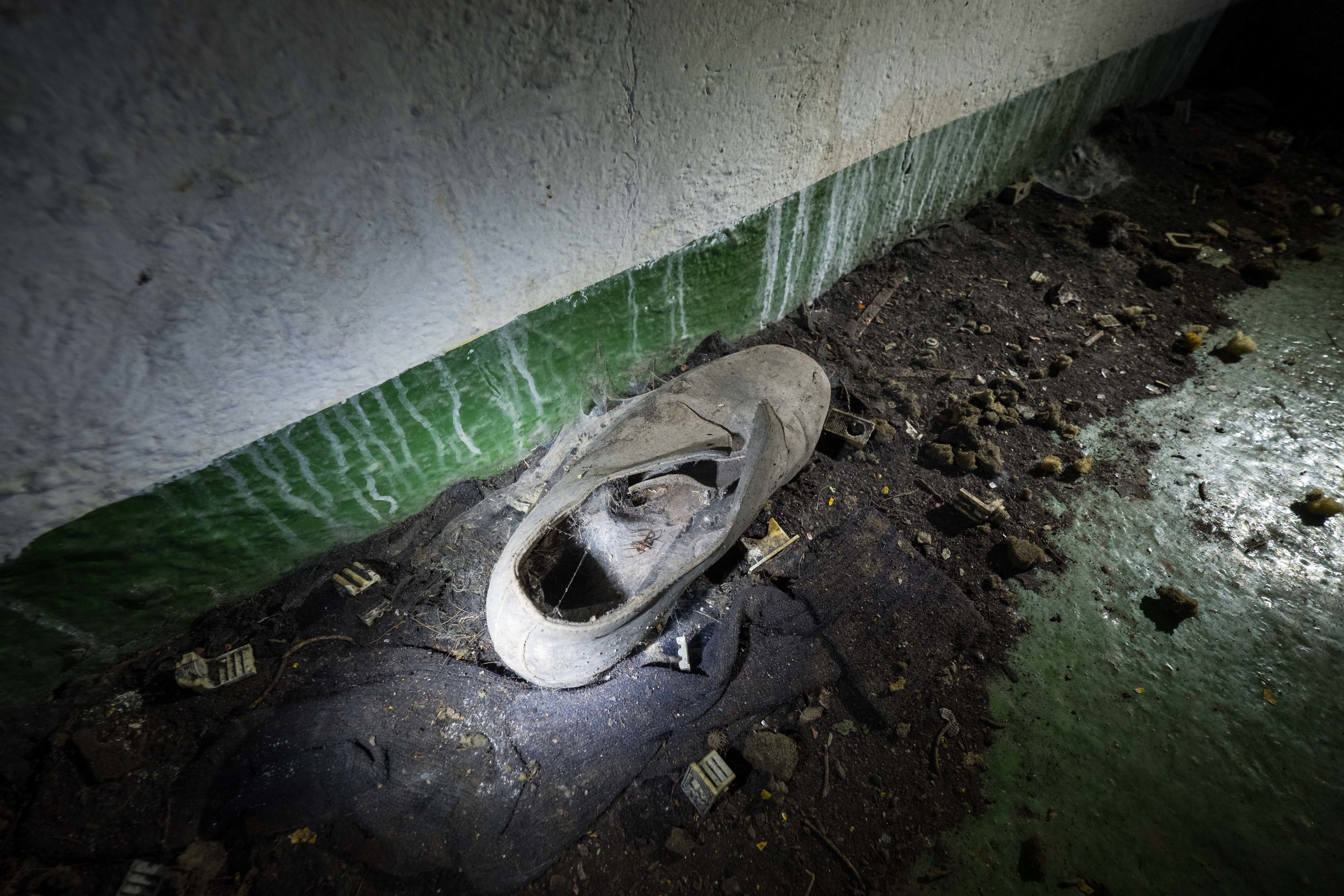 why are there always old shoes at abandoned sites?