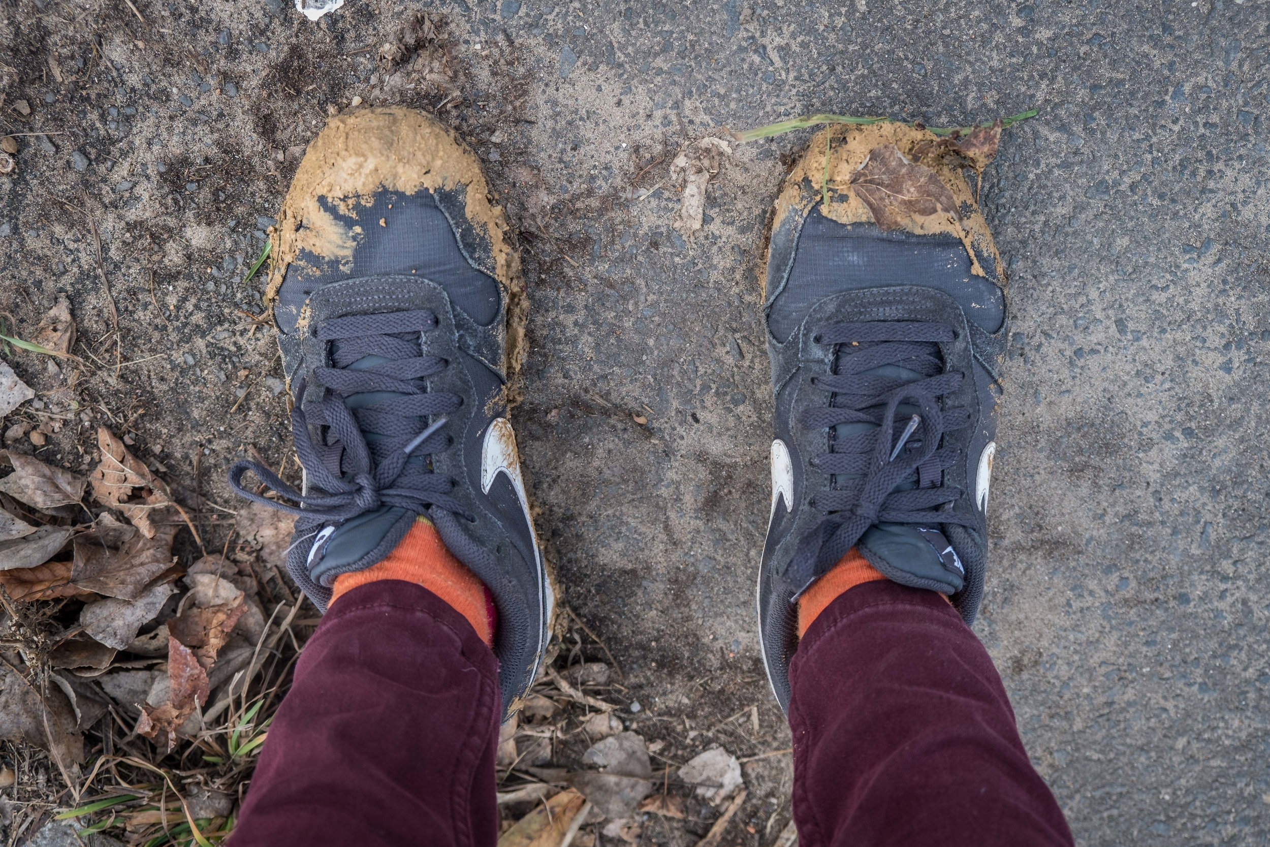a week of rain + recent demolition = muddy shoes