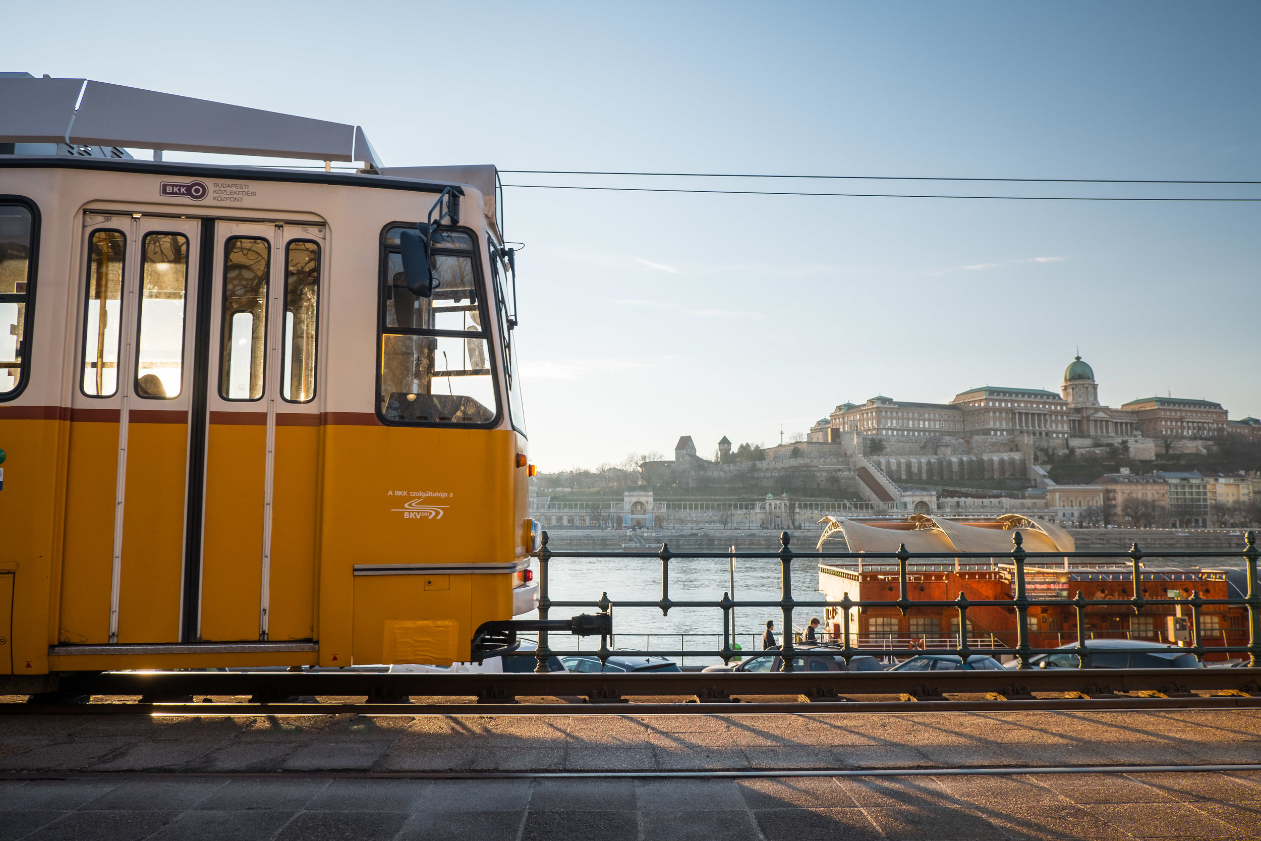 Tram No. 2 along the Danube River with Buda and Buda Castle in the background