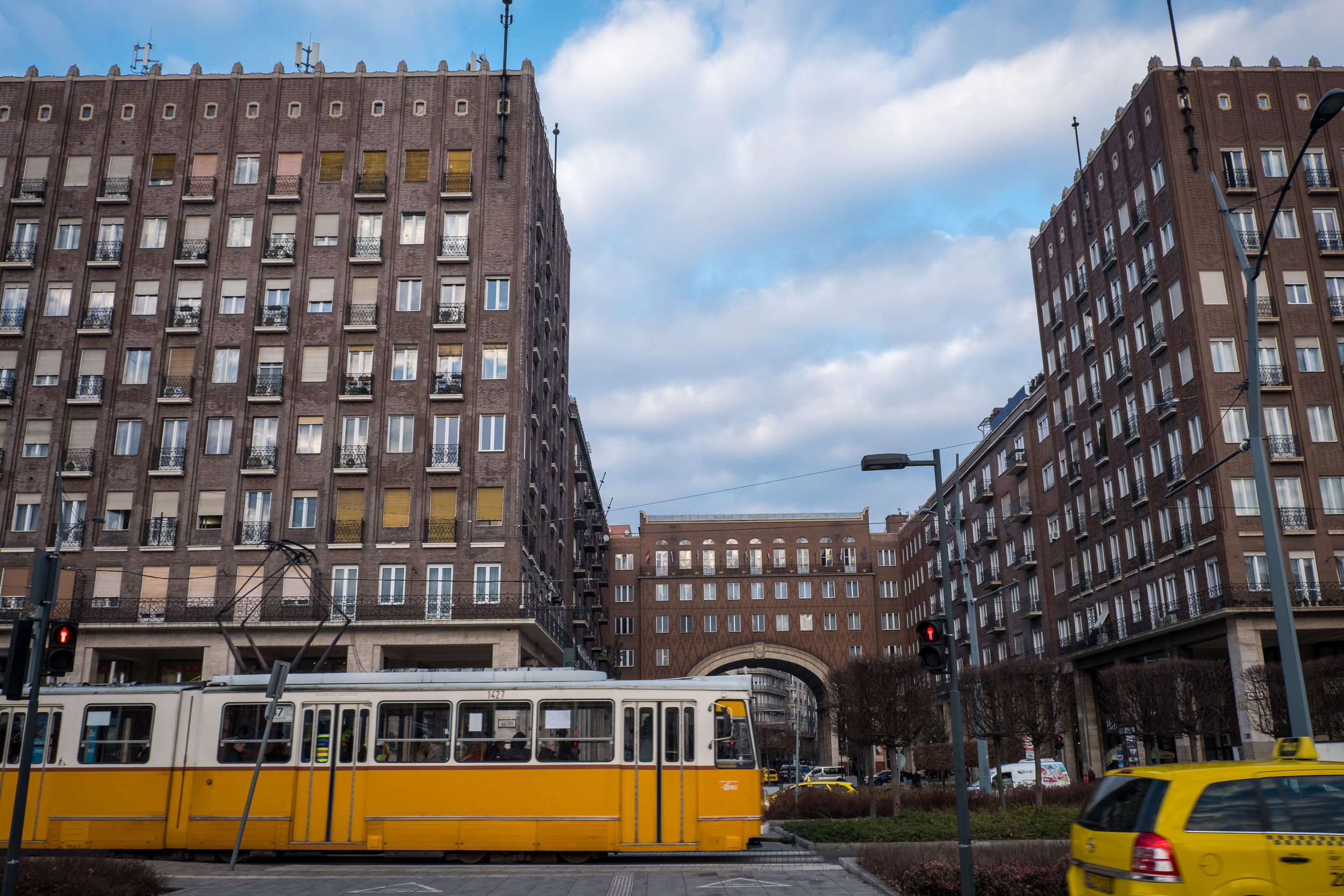 a tram passes Madách Imre Square (a very Hamburg/Chilehaus complex!)