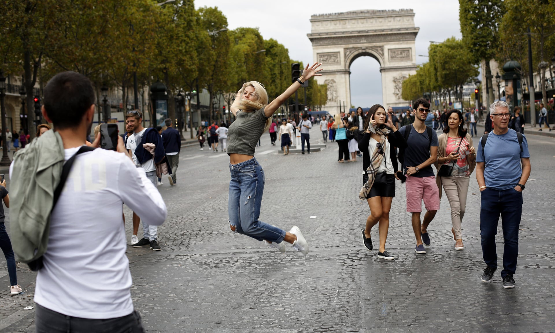 "Parisians say ""oui oui"" to going car free (photo credit  theguardian.com.uk )"