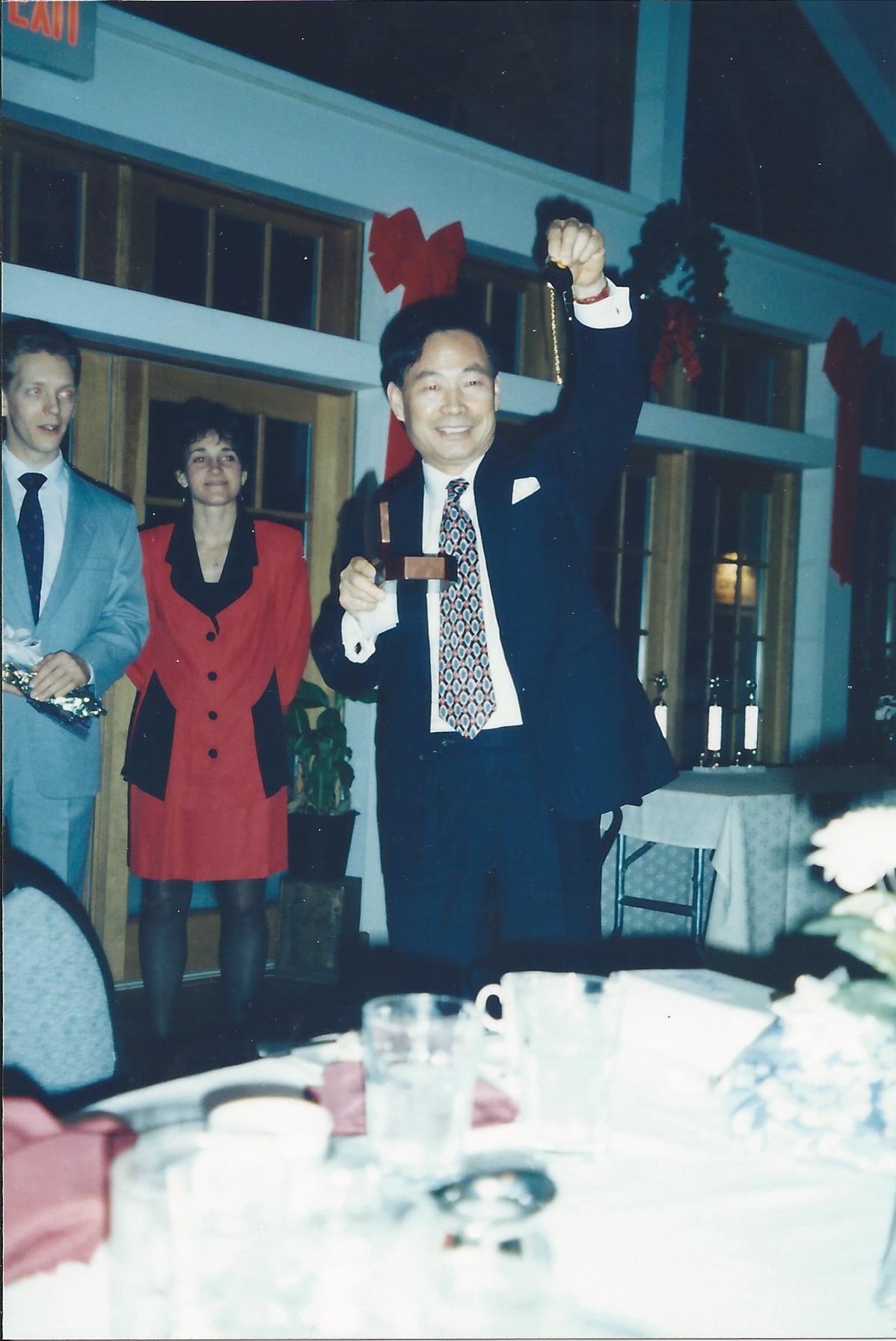 0350 Banquet Mr. Lee holding his pocketwatch.jpg