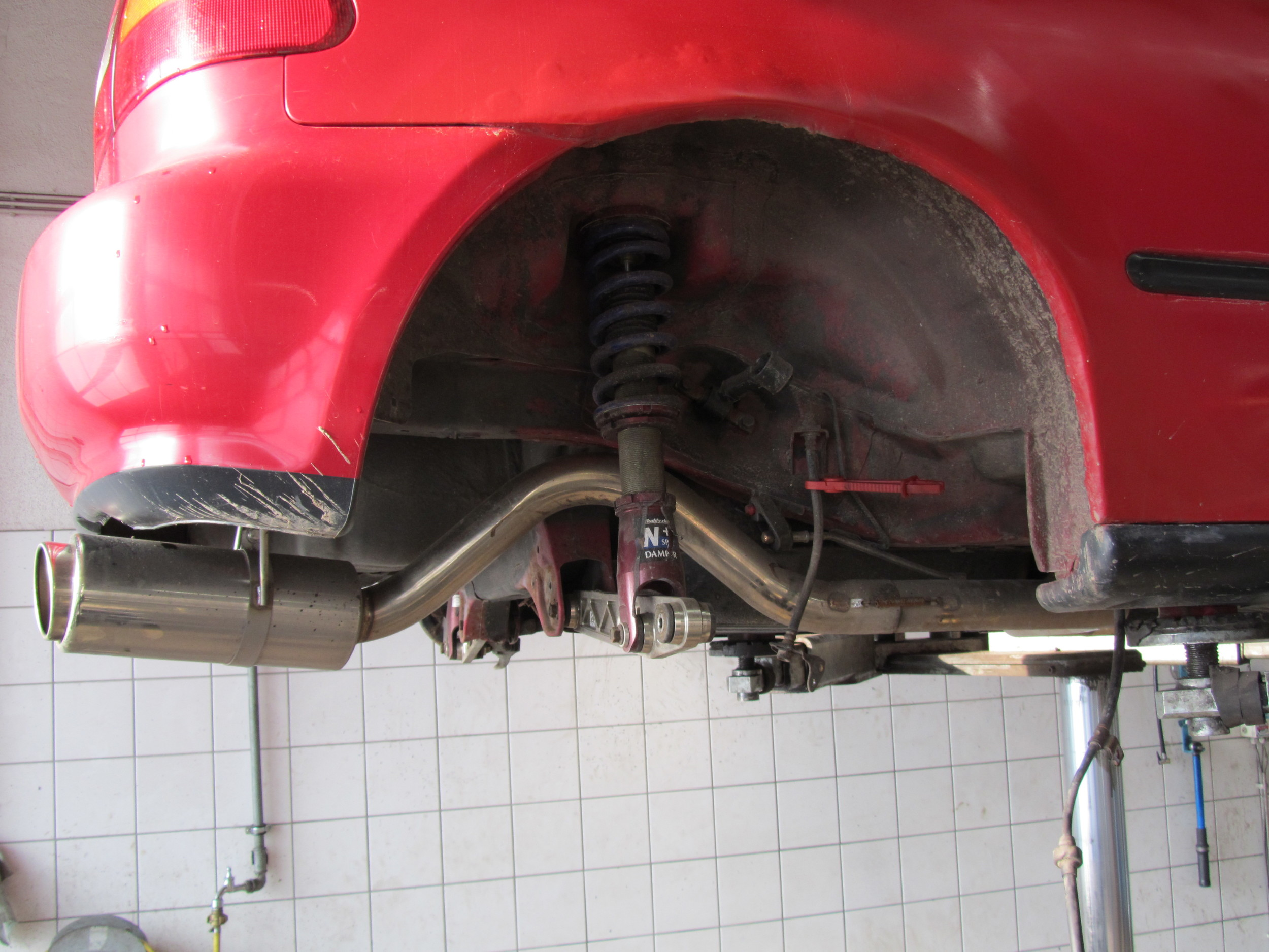 """2. Then we disconnected the trailing arms from the suspension and body so they would just """"drop out""""."""