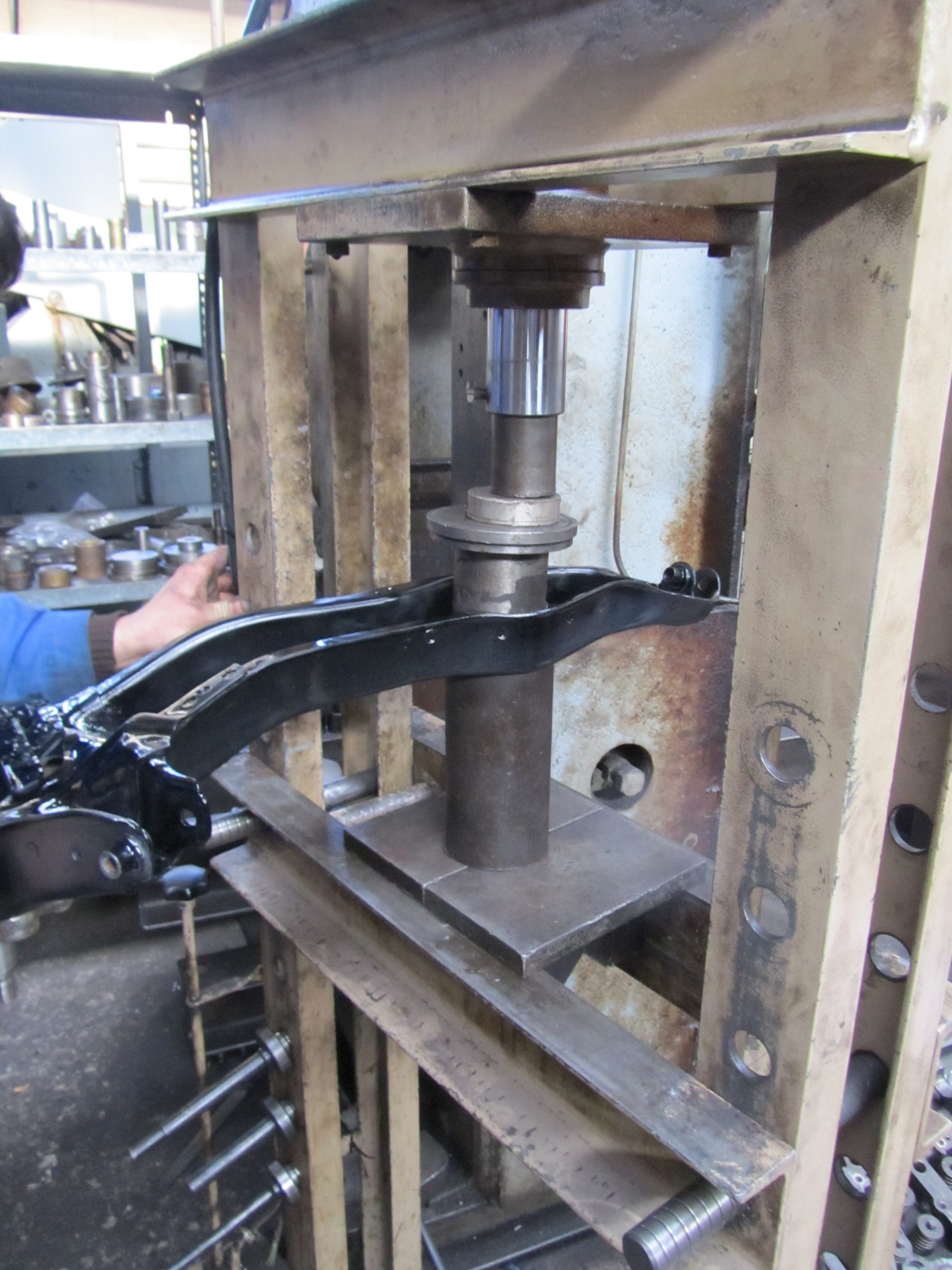 3. Once that was done, we used a press to get the old trailing arm bearings out and get their new Spoon counterparts in.