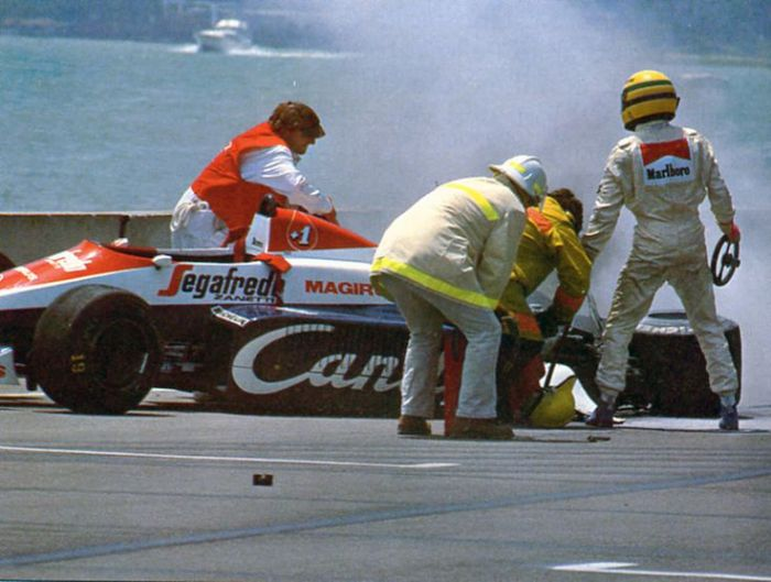 Senna out of the car after his Detroit shunt.