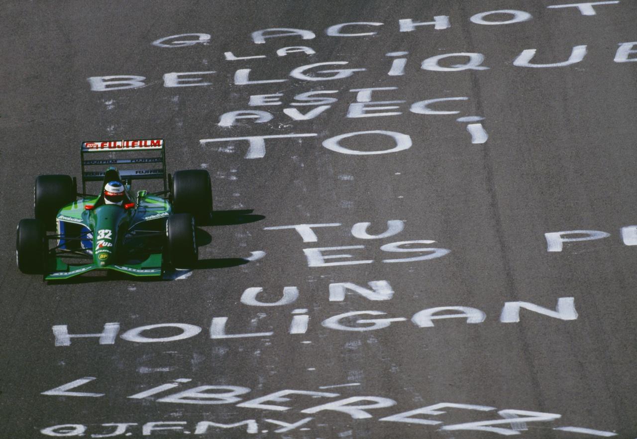 Michael Schumacher flies over pro-Gachot graffiti left by disgruntled Belgian fans.