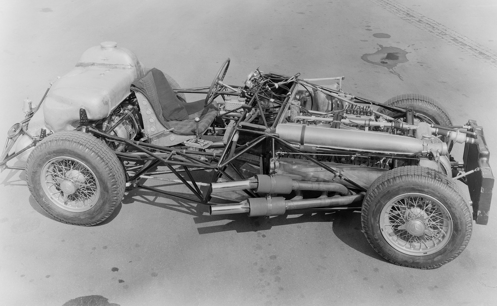 The 300SLR undressed, note the peculiar exhaust arrangement.