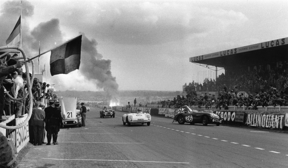 The stricken Healey of Lance Macklin. Pierre Levegh's 300SLR burns in the background.
