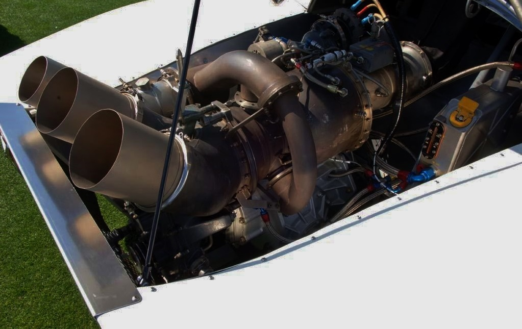 The turbine engine showing its exhaust and wastegate pipe (left).
