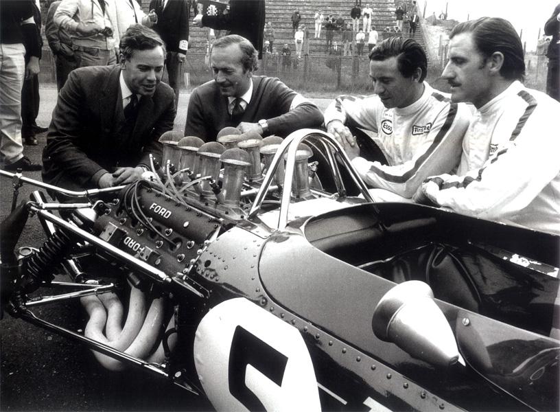 Cosworth's Keith Duckworth, Colin Chapman, Jim Clark and Graham Hill admiring the new DFV, Zandvoort 1967.