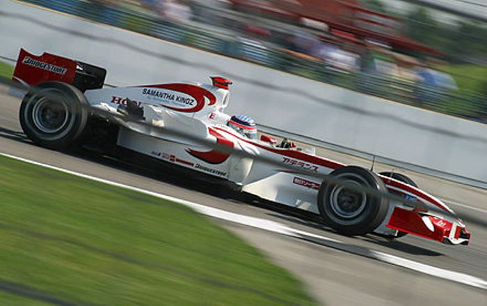 Sato driving the SA05 around Indianapolis.