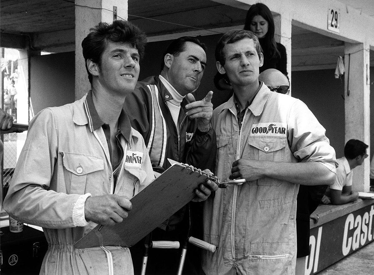 Sir Jack Brabham (center) and Ron Dennis (right), Nürburgring 1969.