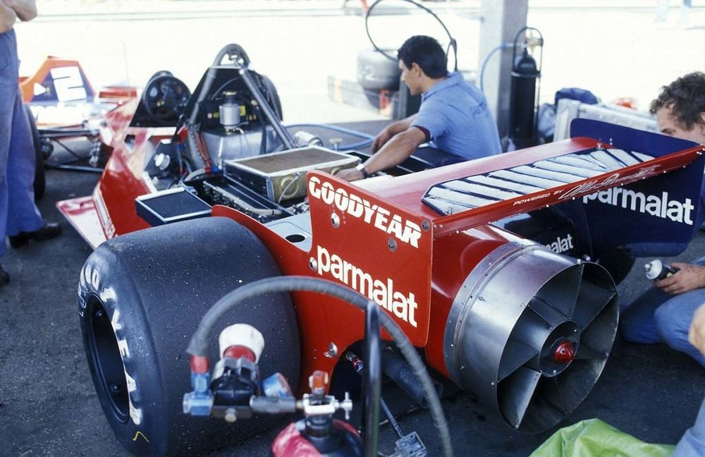 The alien rear view of Brabham's innovative machine. Note the top-mounted radiator.