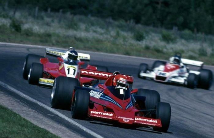 Niki Lauda lapping the 10th placed Carlos Reutemann's (ARG) Ferrari and the 11th placed Hans Joachim Stuck (GER) in his Shadow.
