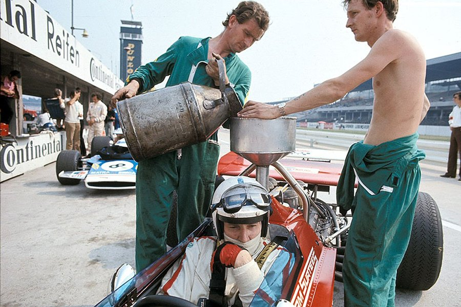 John Surtees receiving a fresh batch of fuel. Hockenheim, 1970 German Grand Prix.