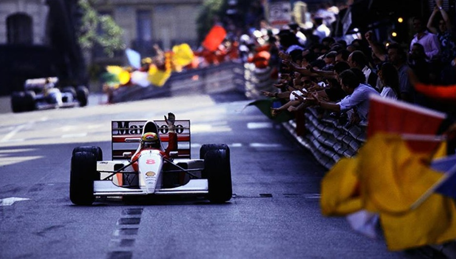 Ayrton Senna celebrating his 6th and final Monaco Grand Prix victory.