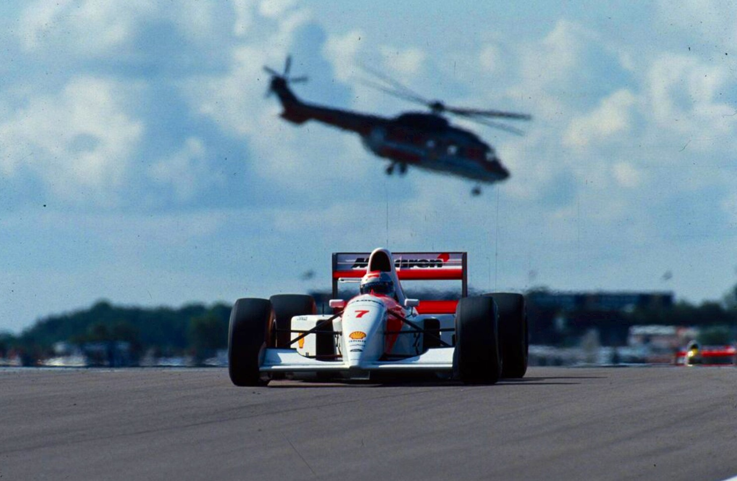 Michael Andretti followed by his illustrious teammate, Silverstone 1993.