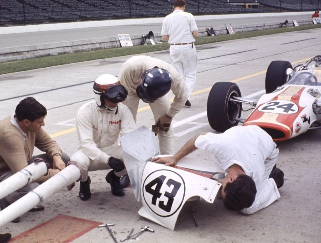 Jackie Stewart and Graham Hill discussing matters in the pits, Indianapolis 1966.