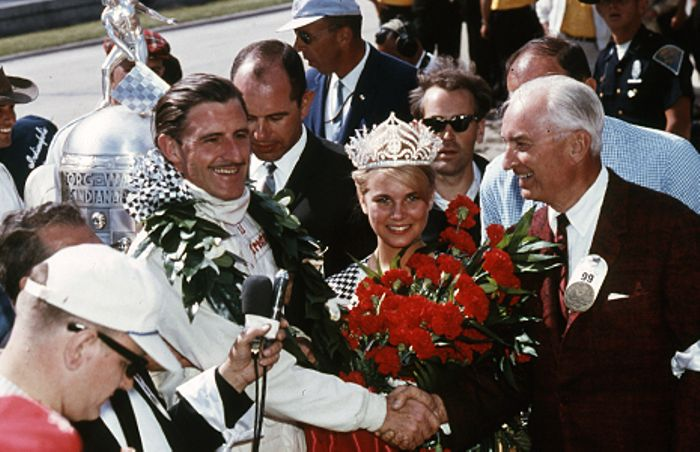 Graham Hill enjoying the festivities on victory lane, Indianapolis 1966.
