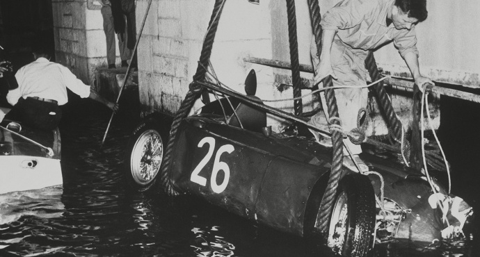 Alberto Ascari's Lancia being lifted from the harbor, Monaco 1955.