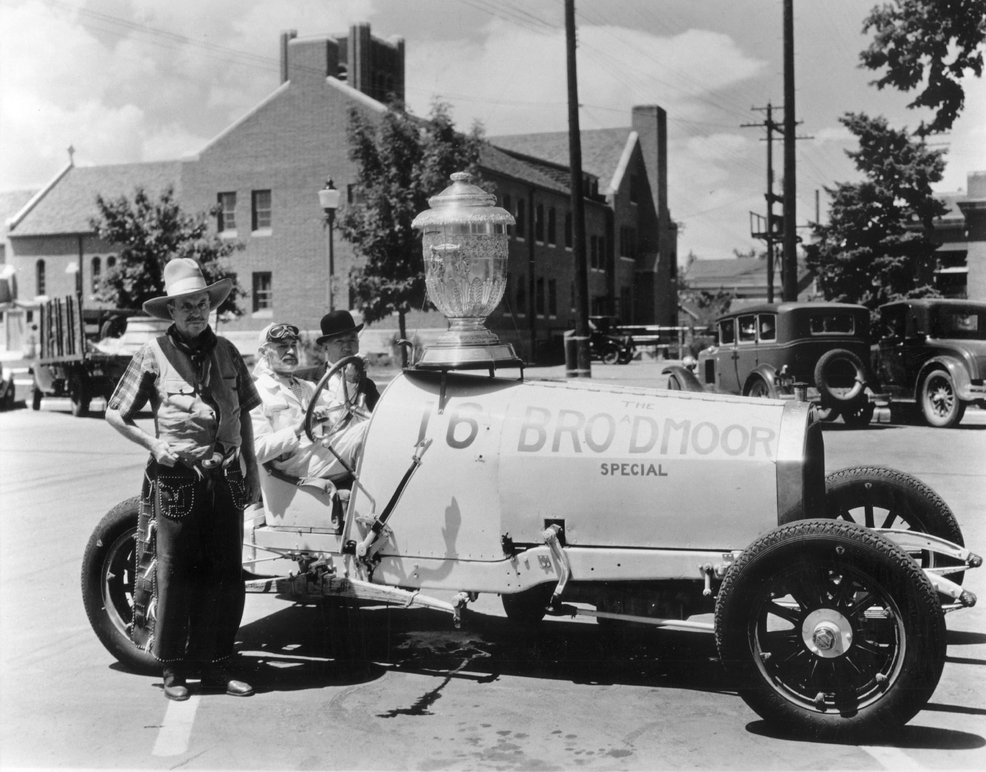 """Spencer Penrose next to Barney Oldfield in the Delage """"Broadmoor Special"""", named after the huge hotel & resort owned by Penrose, Pikes Peak 1916."""