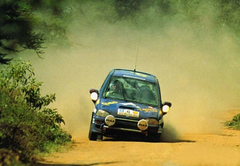 Colin McRae trying his best to ignore the state of his stricken car.