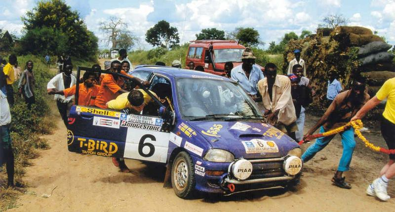 McRae and a helpful band of locals pushing the car to the finish in the Kenyan heat.