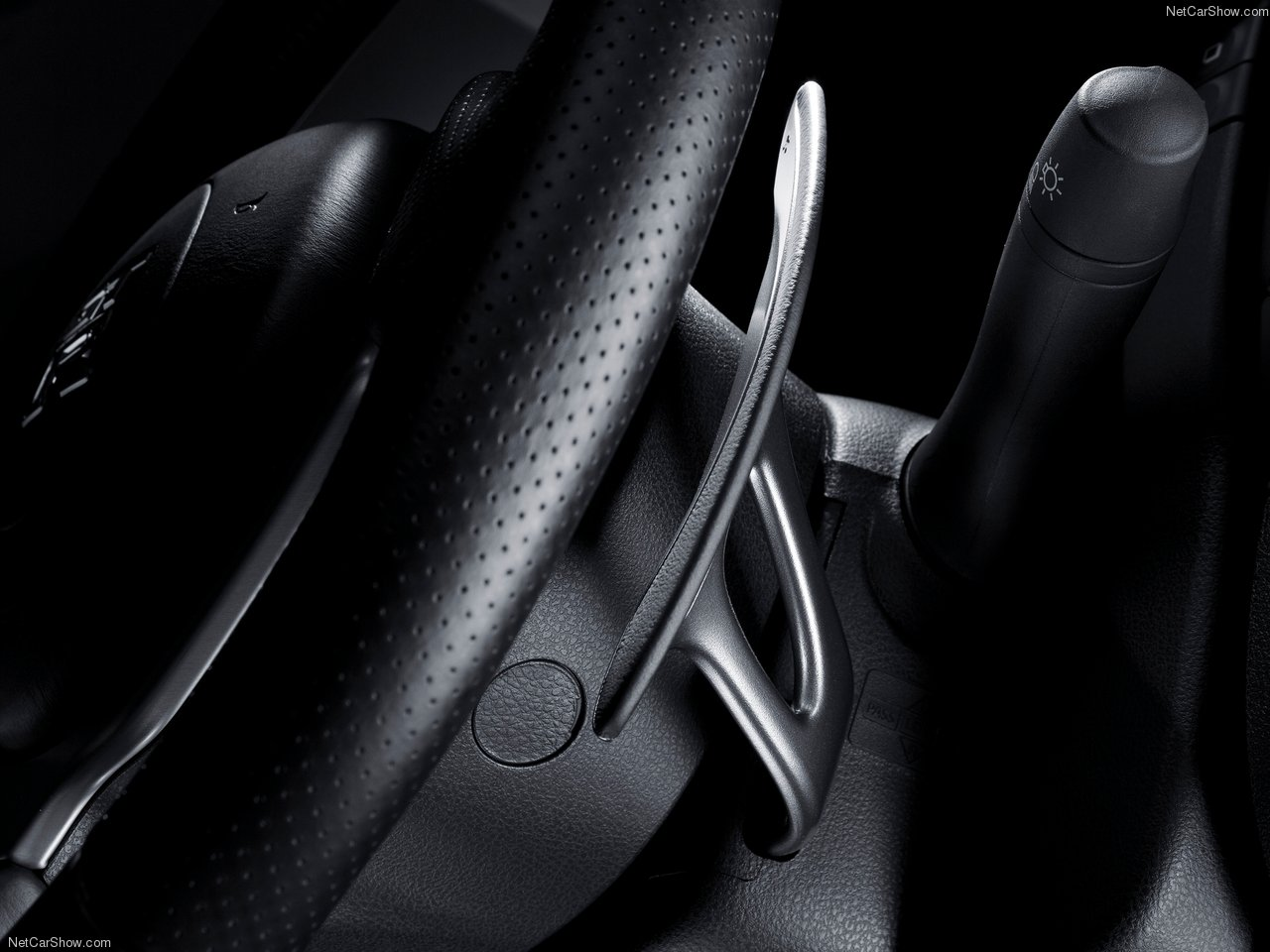 The shifter paddles hidden behind the steering wheel.