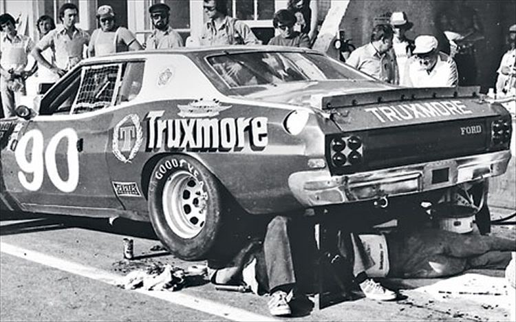 The Donlavey crew taking a look at the overheating differential, Le Mans 1976.