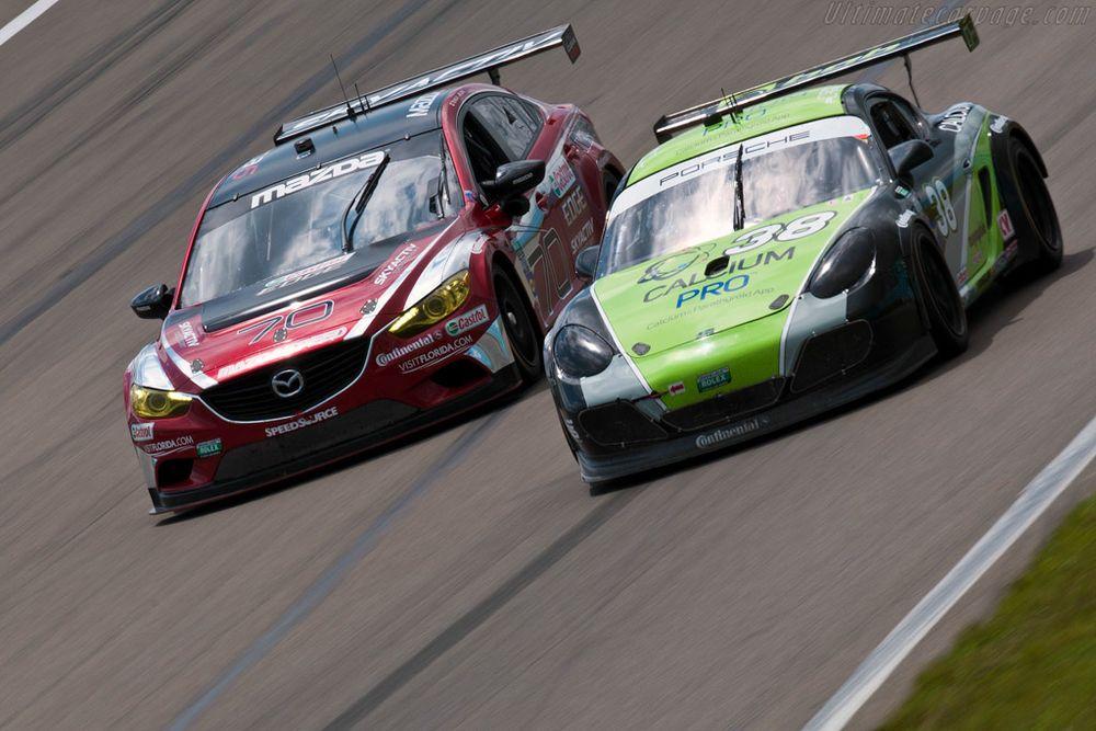 Mazdaspeed battling its archnemesis, the BGB Motorsports Porsche Cayman GX.