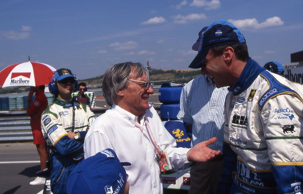 """Sorry Johnny, I'm going to have to ask you to leave..."" - Bernie Ecclestone and Giovanni Lavaggi having a friendly chat, 1996."