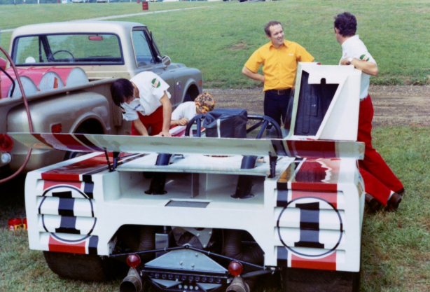 Haas mechanics working on Stewart's T260 in the paddock, Mid Ohio, 1971.