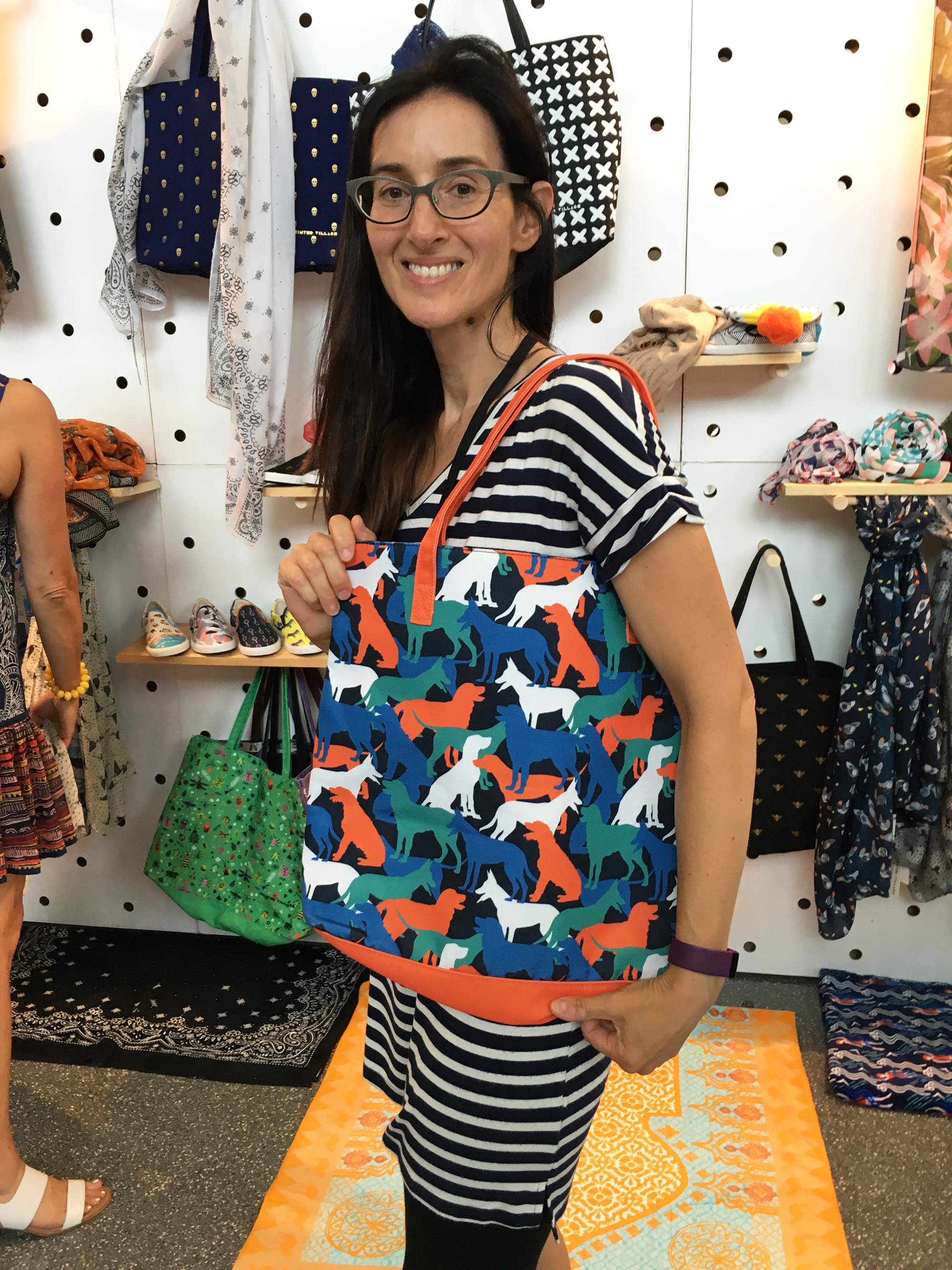 at the Printed Village booth posing with my dog pattern tote bag!