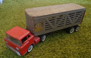 Red Structo Farms semi truck.jpeg