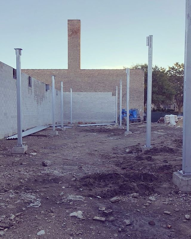 One of the many amenities at Elevation Lofts will be a gated parking lot located adjacent to Rogers Ave. Select parking stalls will also include covered parking. Steel columns that will comprise our parking lot's overhang (and building's floorplate) was just installed this week.