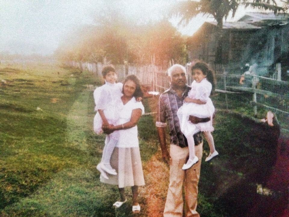 My grandparents on my mama's side pictured with my sisters in Guyana