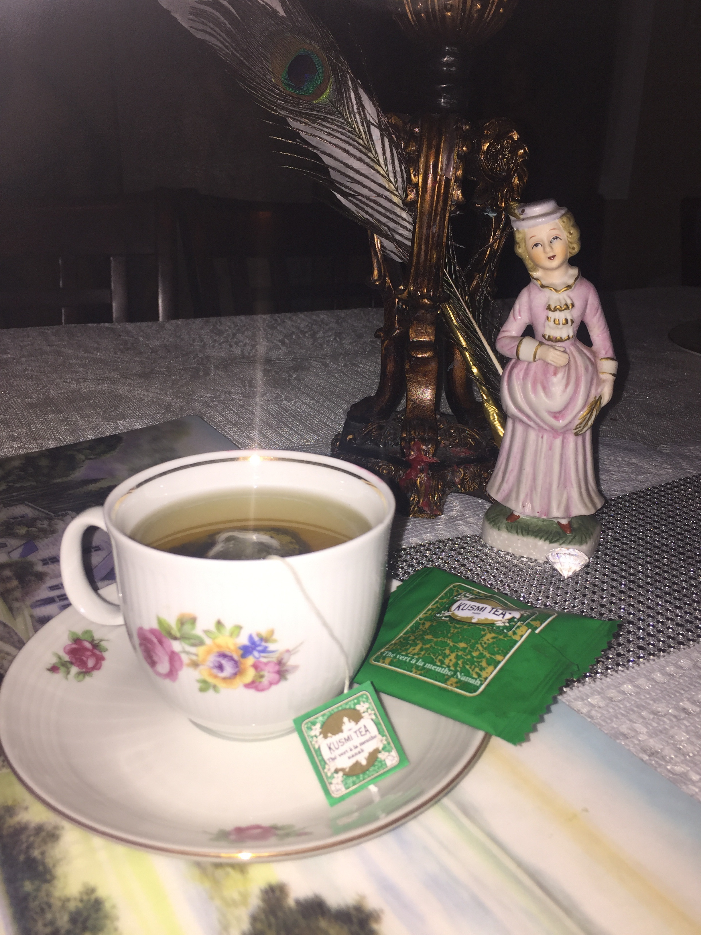 Fine china, Kusmi Parisean tea and Peacock feathers to signify Royalty, elegance and intellegance. (Research peacock significance for more!)