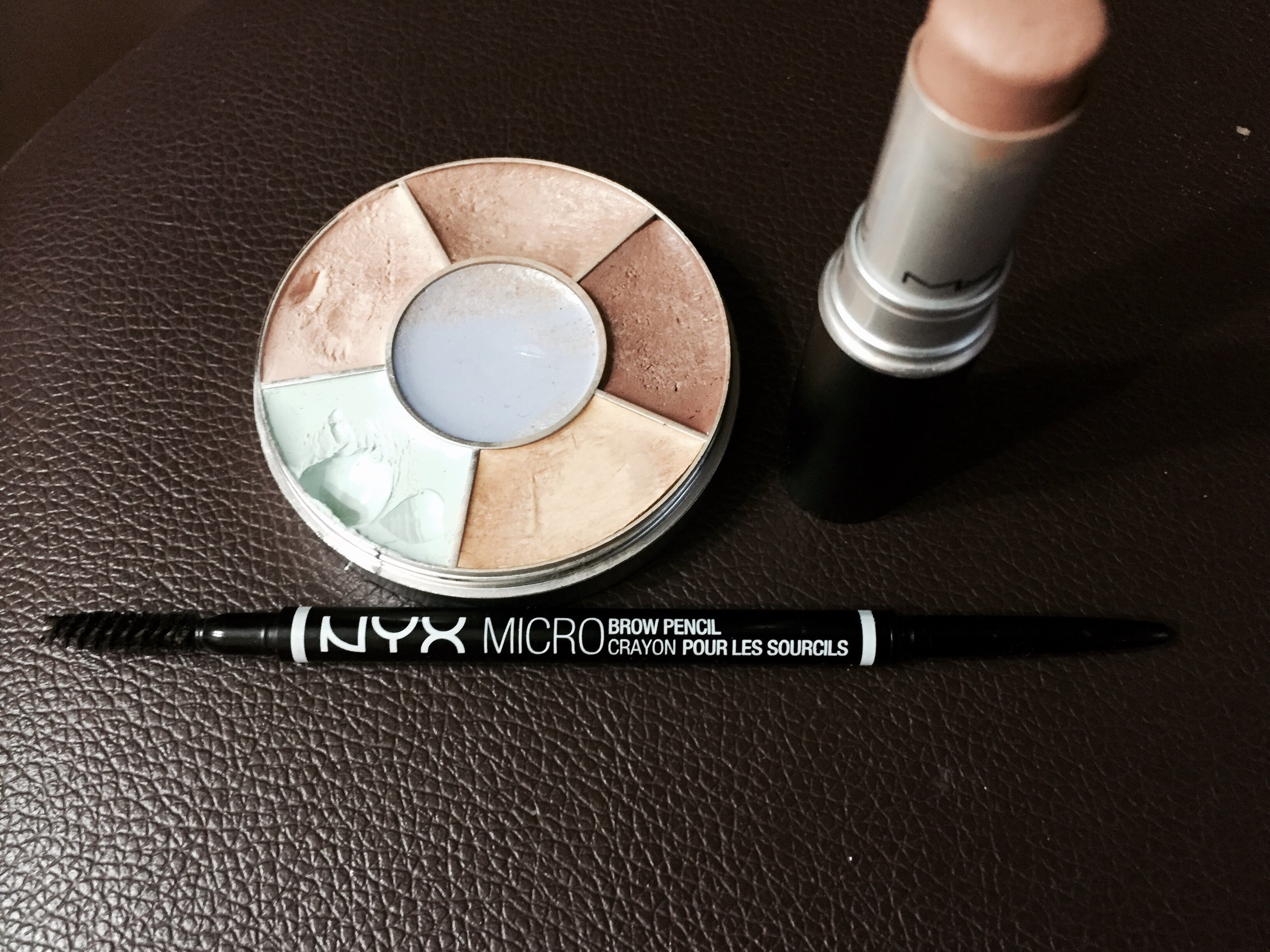 Colour corrector wheel to conceil imperfections and brow pencil/brush