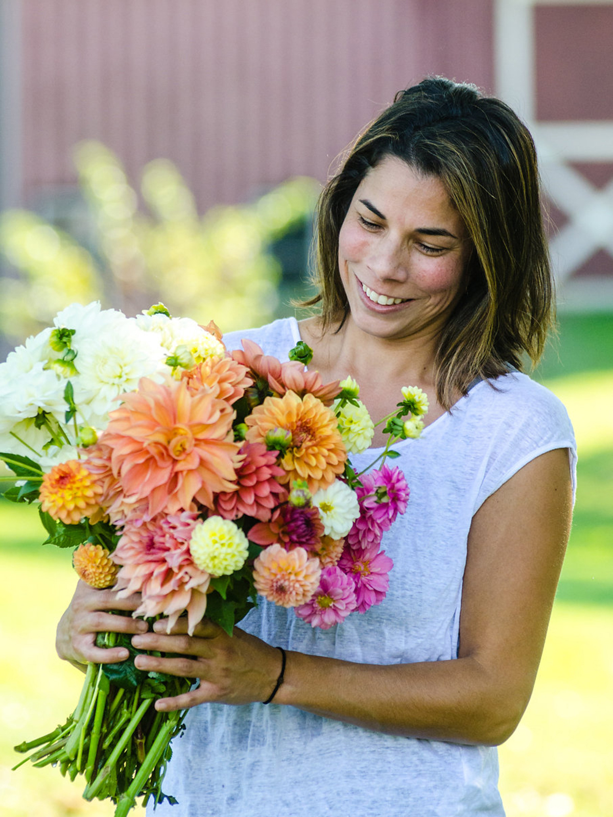 Mara with a bouquet of flowers from her farm (by Sue Reno)