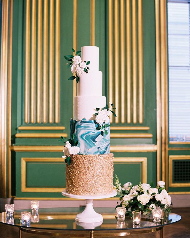 This @bttrcrmbakeshop show stopper was featured in the new @mlweddingswashington for Grace and Stash's wedding! This design was so elegant and classic, with fun textures and a pop of the couple's signature color...and can you believe those aren't real flowers?! When your cake looks like art, you display it all night, and guests were in awe of this beauty. Check out the full story, in print now! . . . . Planning + Design: @idaroseevents | Photography: @abbyjiu | Flowers: @darlinganddaughters | Catering: @occasionscaterers | Cake: @bttrcrmbakeshop | Makeup + Hair: @makeupbyanab | Invitations + Signage: @parisadamian | Calligraphy: @calligraphetteco | Escort Display: @brightlyeverafter | Rentals:  @smthingvintage | Linens: @bbjlinen | Band: The Rollex Band | Lighting: @atmolighting | Drape: @fabeventsdc | Customers Welcome Gifts: @marigoldgrey | Dress: @carinesbridal