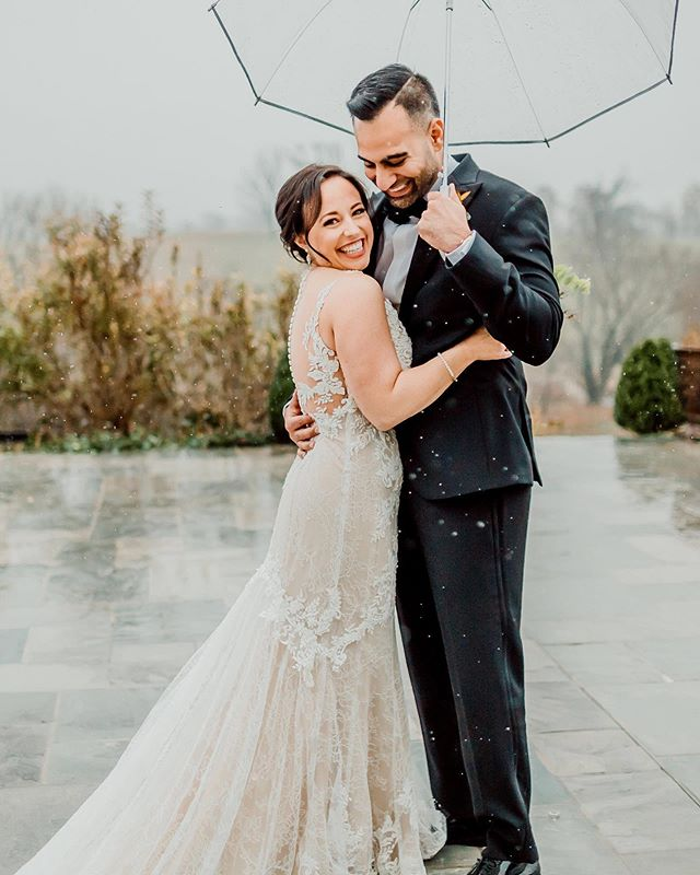Obsessed with these two and their romantic, rainy first look 😍. This photo right here shows that when you embrace nature, magic can happen ☔️! I can't wait to share more from this beautiful day- Check out Kelsey & Niket's feature in the new @mlweddingswashington magazine, out now!!! . . . . Planning + Design: @idaroseevents | Photography: @hayalexandraphotography | Flowers: @loblollyfarm | Catering: @savoirfarelimited | Cake: @sweetsby_e | Makeup: @mubs_ponehgray | Hair: @apothicstudio_oneloudoun | Invitations: @mintedweddings | Signage: @leahletters_ | Rentals: @selecteventgroup | Jazz duo: @kushnerentertainment | DJ: DJ Vicious | Venue: @shadowcreekweddings