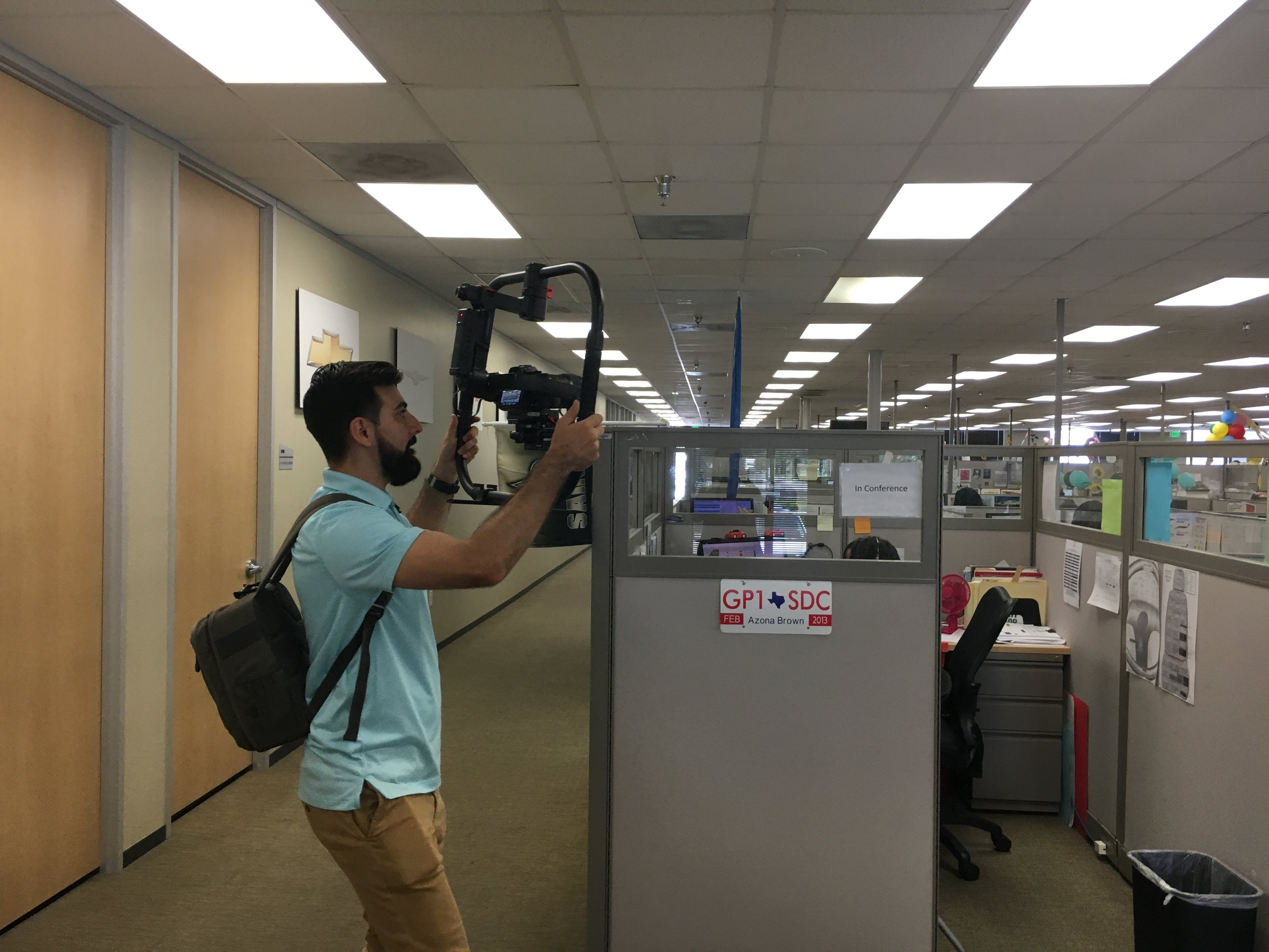 Behind the scenes! Our video ninja filming B-roll of the offices.