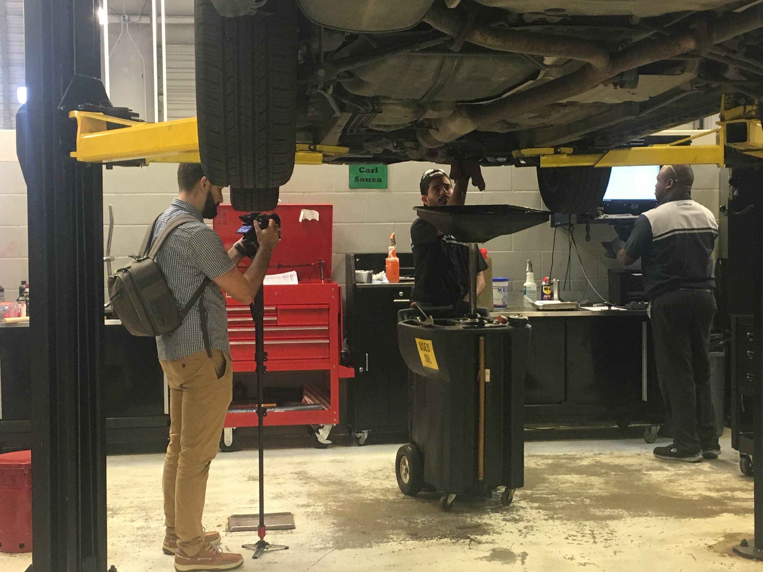 Behind the scenes! At brand28, we love capturing the culture of an organization. Shown is our video ninja getting down and dirty with the Group 1 Automotive mechanic crew.