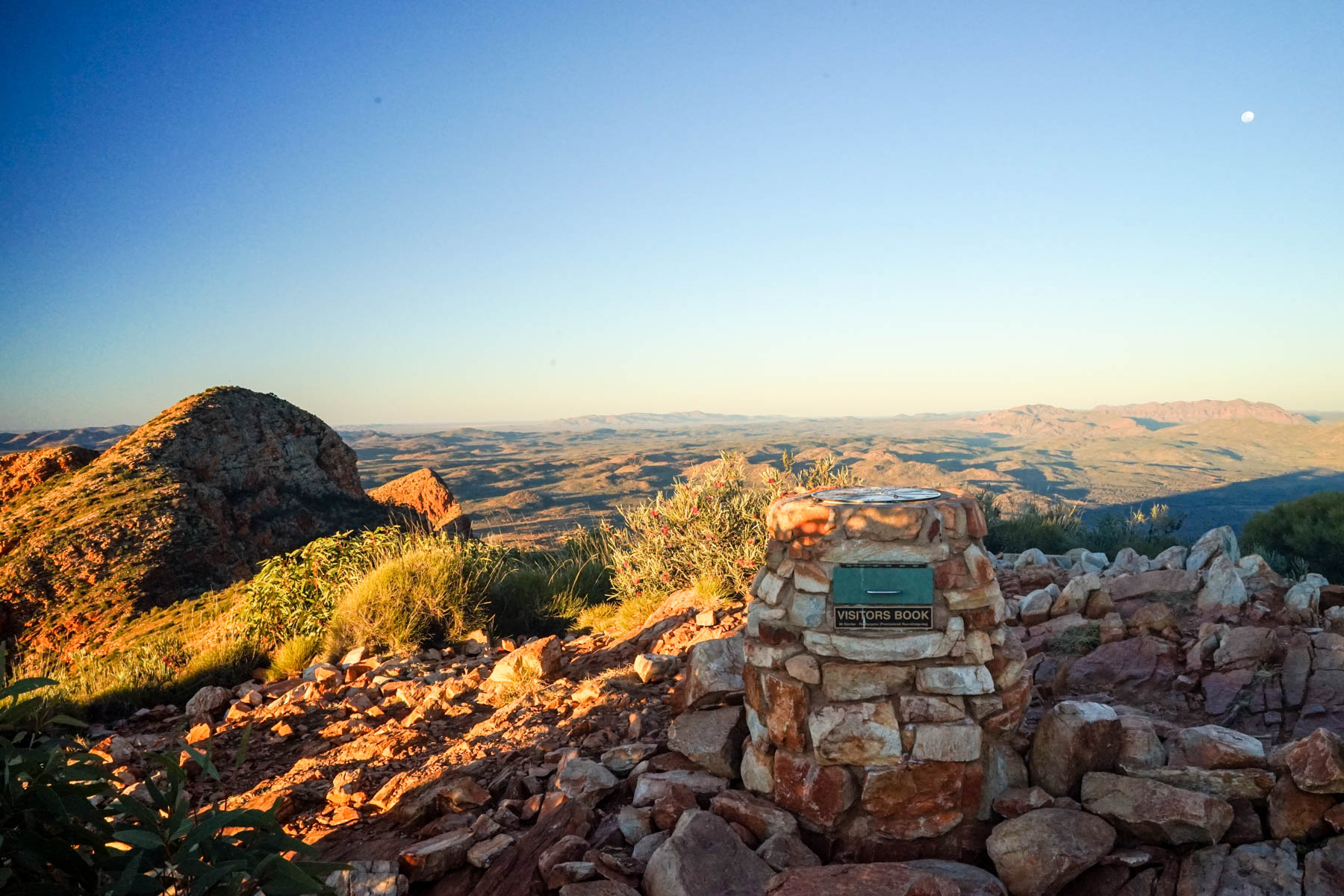 The summit of Mount Sonder at sunset. The summit marks either the start, or end of the Larapinta Trail, depending on which way hikers are walking it.