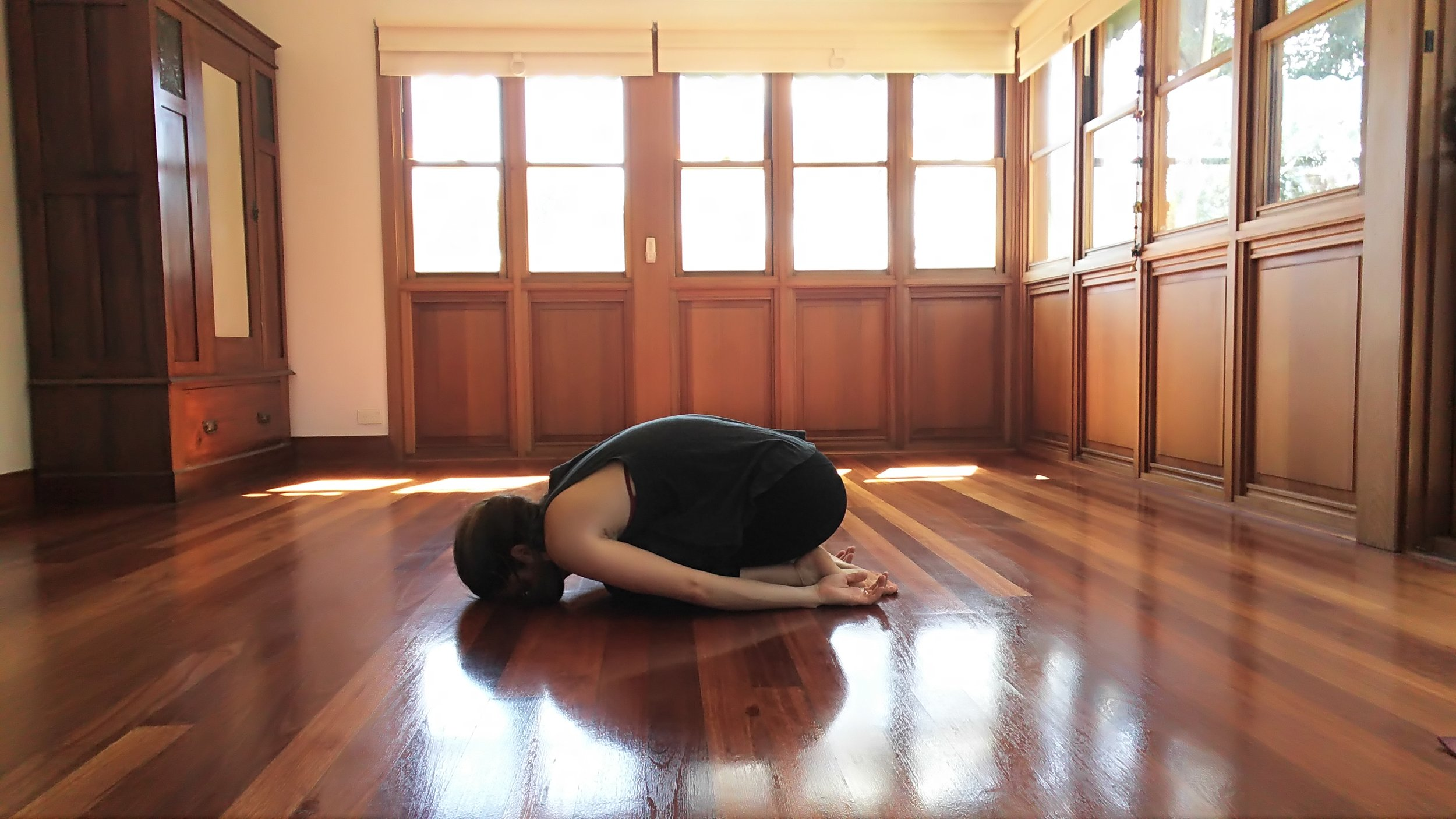 Rest. Childs pose. Bring feet and knees together. Allow head to rest on the floor or a block. Bring arms towards feet. Allow hips to fall towards the feet.