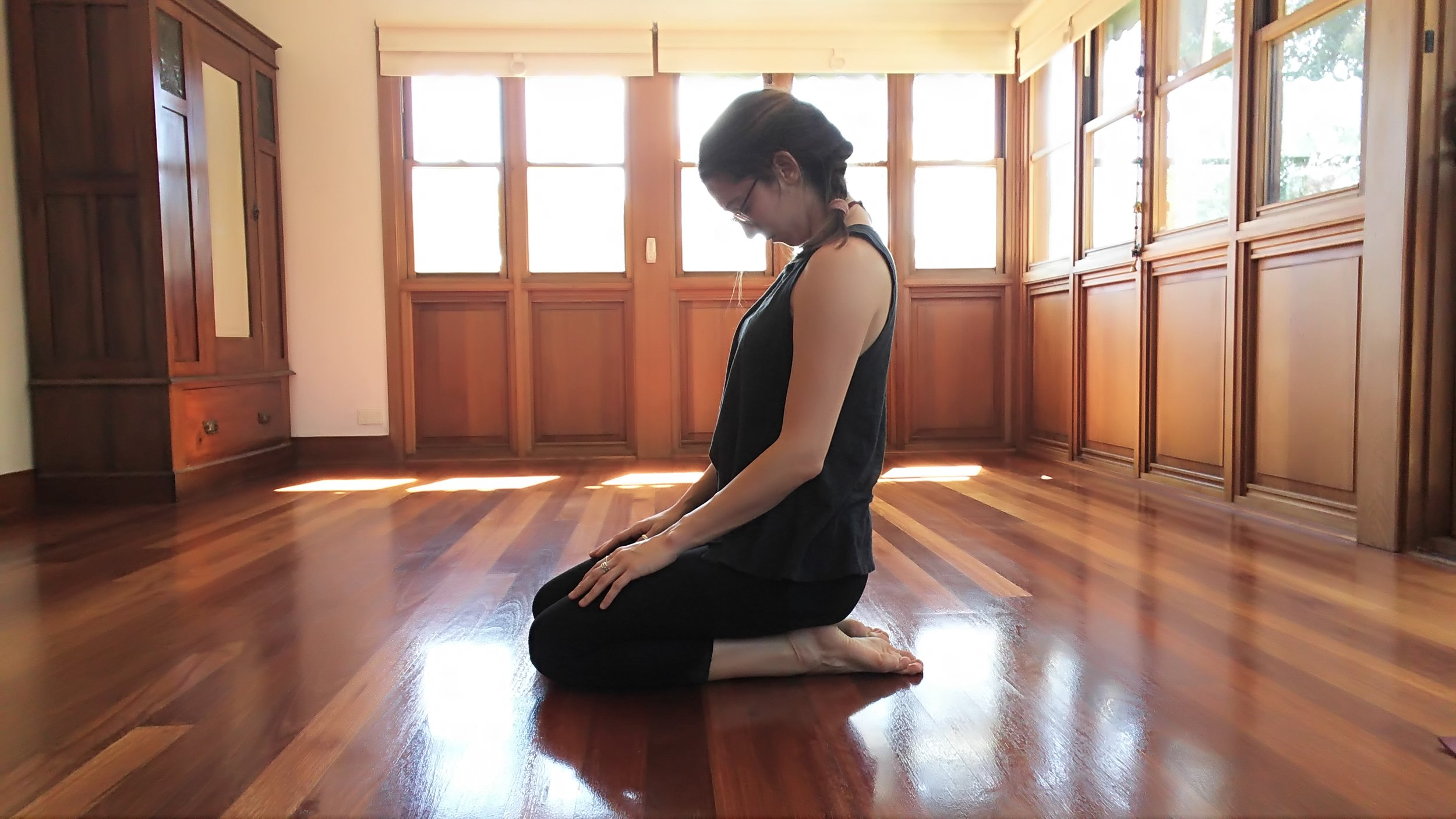 Sit on the knees or in any comfortable seated position. Slowly let the head fall forwards. Let gravity stretch the back of the neck.