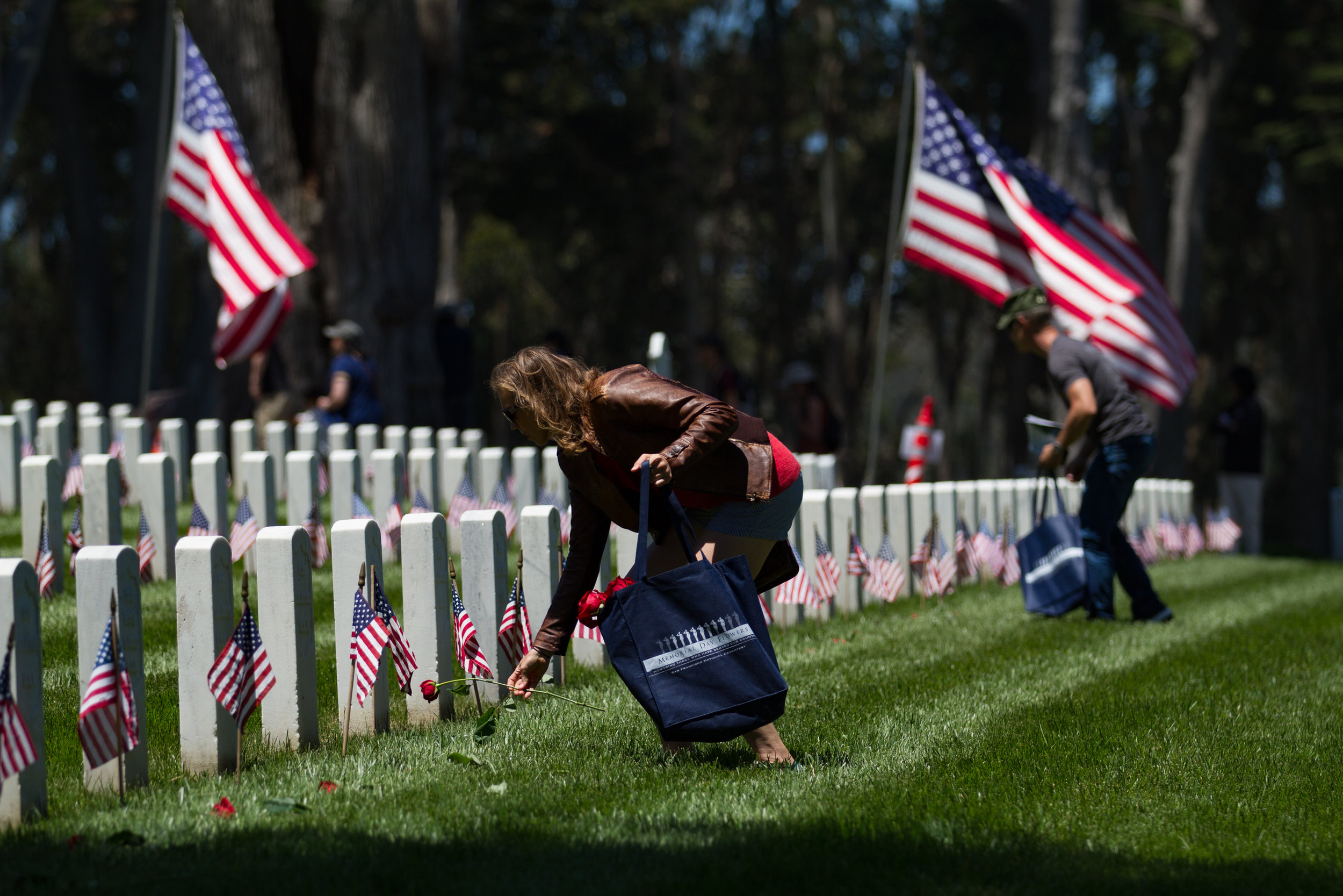 Attendees of the 2018 Memorial Day Commemoration at the Presidio in San Francisco lay roses across the graves of fallen service members. The 150th anniversary pays homage to the over 1 million Americans killed while serving in the armed forces and the annual commemoration is the largest in the West. Services began with a 21 gun salute from the U.S. Army's Pacific Division 75th Training Command and featured speakers Senator Dianne Feinstein, Lieutenant Governor Gavin Newsom, and San Francisco Mayor Mark Farrell.