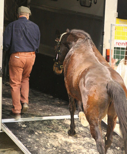 Monty Roberts loading a horse
