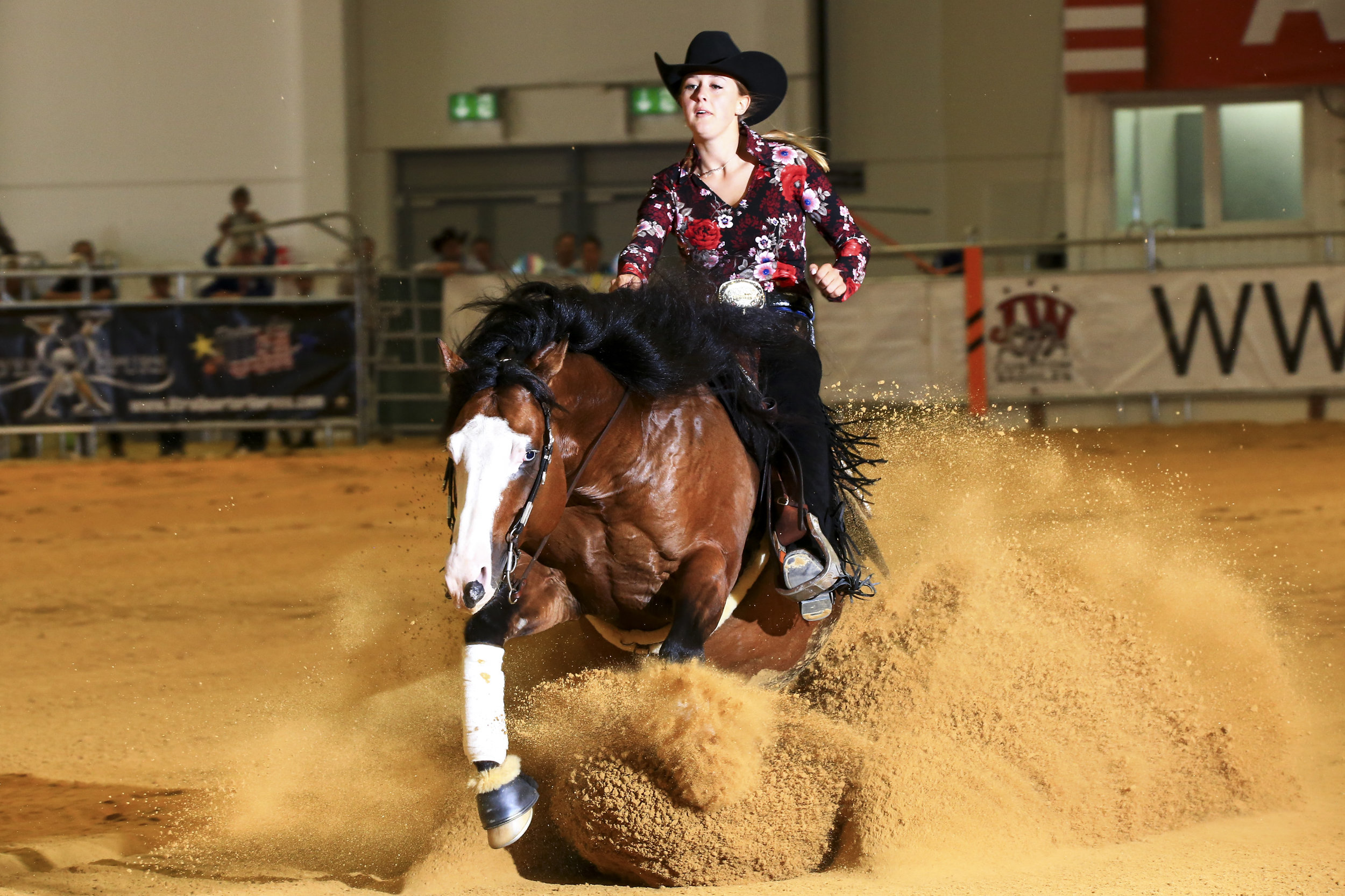 Gina-Maria Schumacher takes Lead in World Cup Bronze Trophy Non Pro Go round - The final of the World Cup Bronze Trophy Non Pro on Sunday should be a sight to see after this great go round! Ten riders in a field of 37 made it to the final, the minimum score being a 214.5. FEI World Champion Young Riders and NRHA World Champion Non Pro Gina-Maria Schumacher took the lead aboard her 7-year-old stallion Gotta Nifty Gun (Dun It Gotta Gun x Custom Nifty Nic) scoring a 221.5 with their fine, smooth run.
