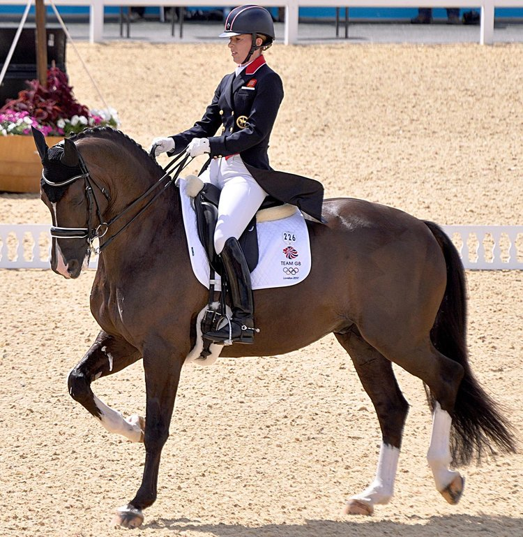 """CHARLOTTE DUJARDIN 2012 OLYMPIC DRESSAGE-1.JPG """"CHARLOTTE DUJARDIN 2012 OLYMPIC DRESSAGE-1"""" BY CHARLOTTE_DUJARDIN_2012_OLYMPIC_DRESSAGE.JPG: EQUESTRIAN DERIVATIVE WORK: NORDLICHT8 - THIS FILE WAS DERIVED FROM: CHARLOTTE_DUJARDIN_2012_OLYMPIC_DRESSAGE.JPG . LICENSED UNDER CC BY-SA 3.0 VIA WIKIMEDIA COMMONS."""